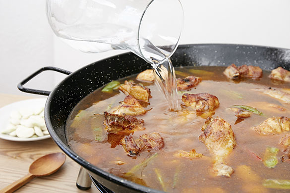 como hacer una paella tradicional
